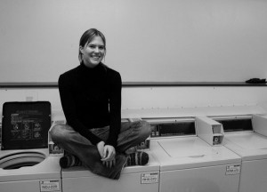 Annalisa Harder explores the world of experiences available at the dormitory laundry room. Photo by Chase Snyder