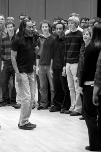A Capella legend Bobby McFerrin conducts a chorus of volunteers from the audience, many of whom are GC choir members.  Photo by Chase Snyder