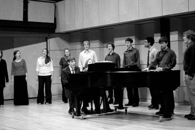 Students perform by the piano in Reith Recital Hall for Jesse Landis Eigsti's senior recital
