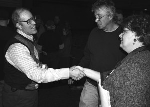 Sustainable farmer Joel Salatin greets fans Molly and Joe Kaniuga after Salatin's speech at the Old Goshen Theatre, Tuesday.
