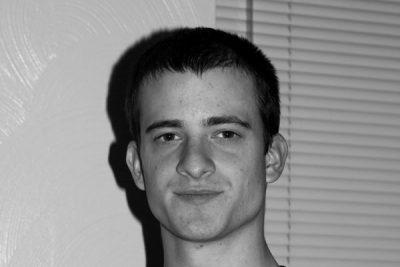 Black and white portrait of Jordan Delp