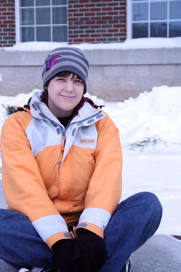 Sarah Noah sits in the snow