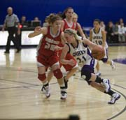 Kelsey Hershberger drives to the basket against IWU in a valiant effort that, nonetheless, resulted in loss. Photo provided by Public Relations.