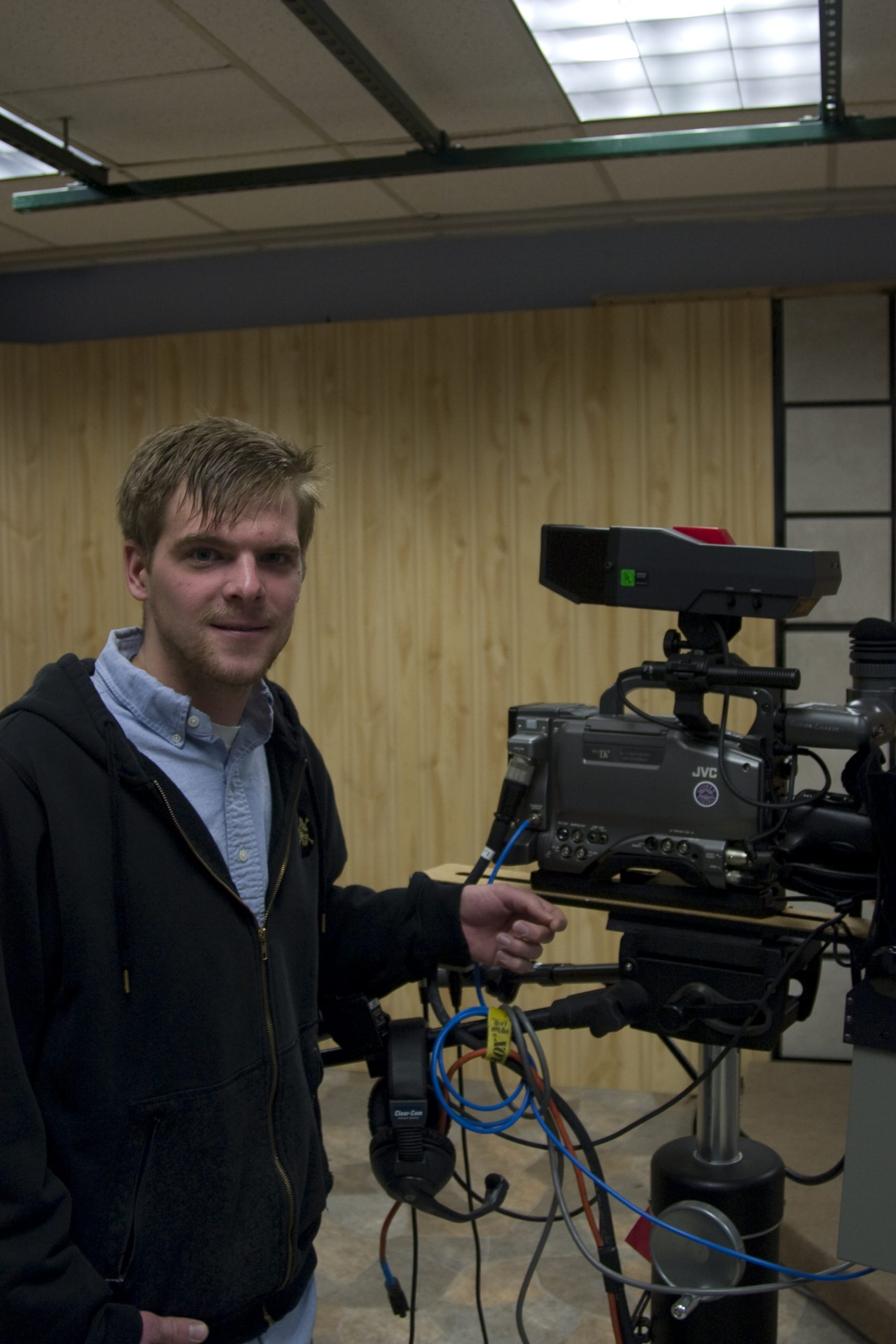 Dusty Diller stands next to a large film camera