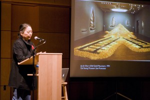 "Hung Liu shows a slide of her piece ""Old Gold Mountain,"" which used over 200,000 fortune cookies.  Photo by Chase Snyder."