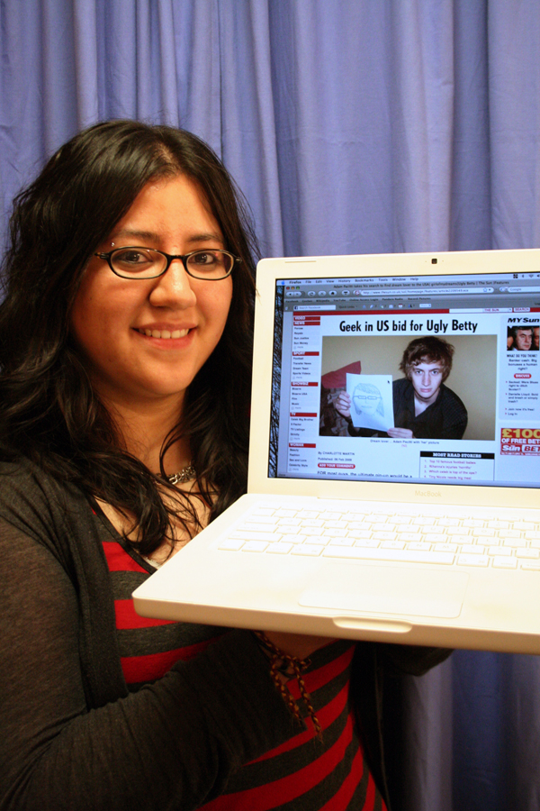 Leah Moreno holds up a picture of Adam Pacitti on her laptop