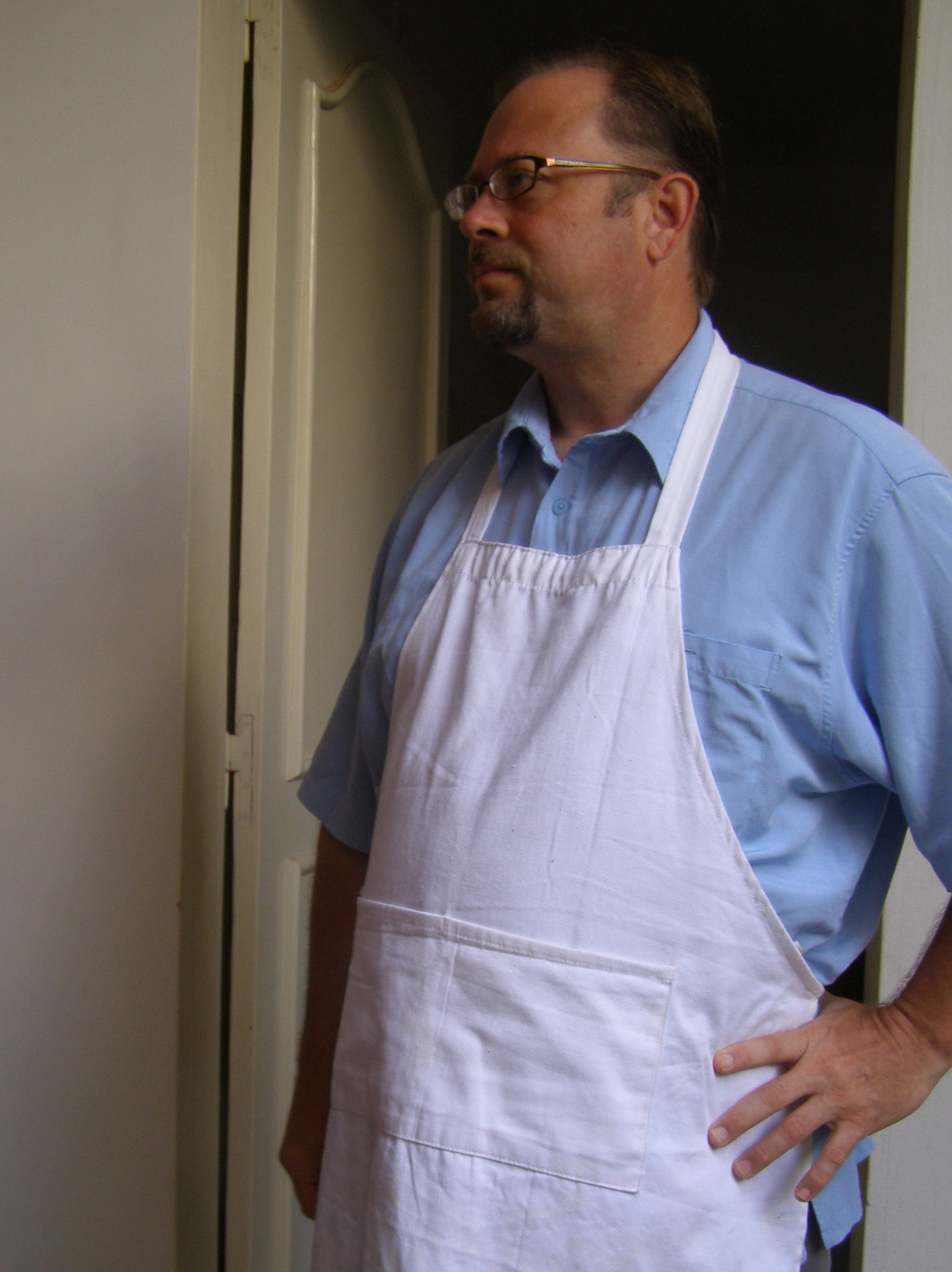 Portrait of Kevin Koch with chef apron on