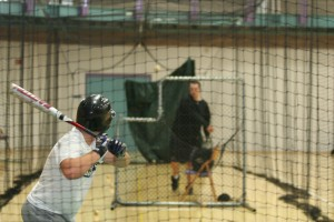 The G.C. Baseball team often practices indoors, using netted batting cages.  Photo by Trisha Handrich.
