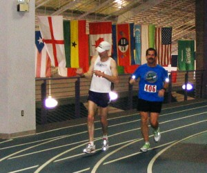 Justin Gillette and Doug Yoder neck and neck in the nations 3rd indoor marathon.  Gillette surpassed Yoder and won the race.  Photo contributed by Doug Yoder.