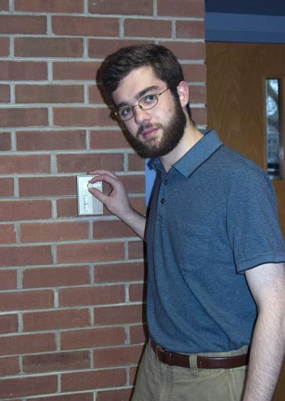 Jesse Shaver flips a light switch