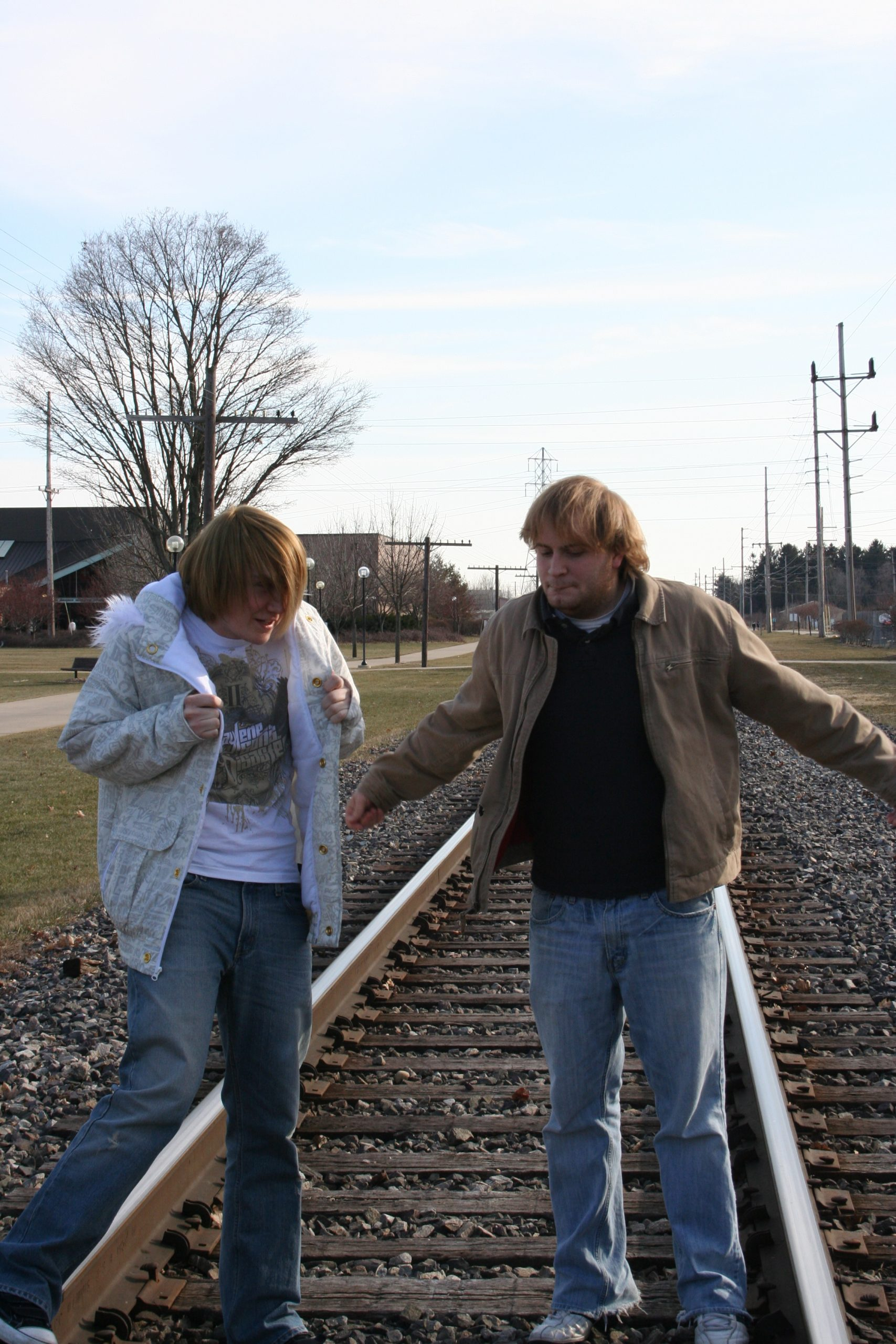 Kevin and Keith stand on the tracks