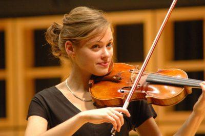 Leslee Smucker plays the violin during a concert in Sauder Concert Hall