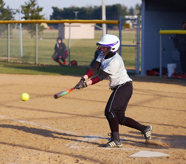 Danae Nafziger takes a swing against Grace College in a recent softball game.  Photo by Jordan Gleason/Goshen College Public Relations.