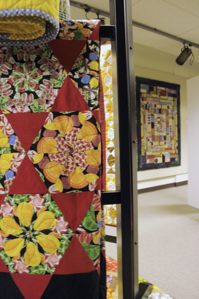Elaborate and colorful quilts hang in the Good Library art gallery as part of a new show.  Photo by Julia Baker.