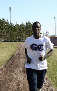 Sam Chege grew up in Kenya and is now a runner for Goshen College.  Photo by Brandon Long.