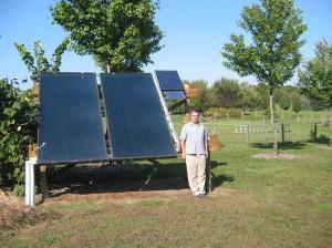 Steve Shantz with a residential solar panel array.  Photo contributed by Steve Shantz.