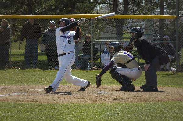 Baseball player hits ball
