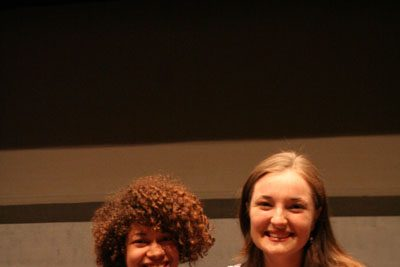 Gina Stutzman and Grace Eidmann sit on the Umble Center stage and pose for a picture