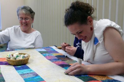 Annalisa works on a quilt