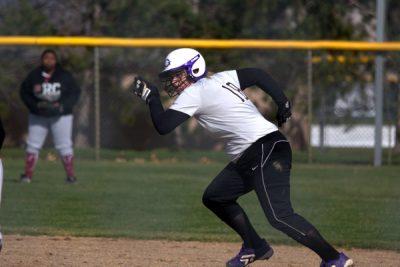 Softball player running bases