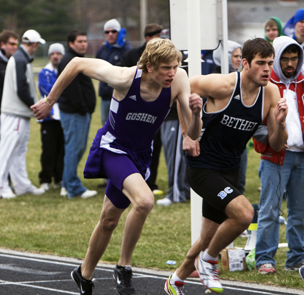 GC frosh Billy Funk (left) pushes forward, racing against a runner from Bethel.  Photo by Brandon Long.
