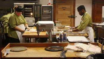 Two chefs work in the kitchen of the recently renovated Westlawn Dining Hall.  Photo by Tim Blaum