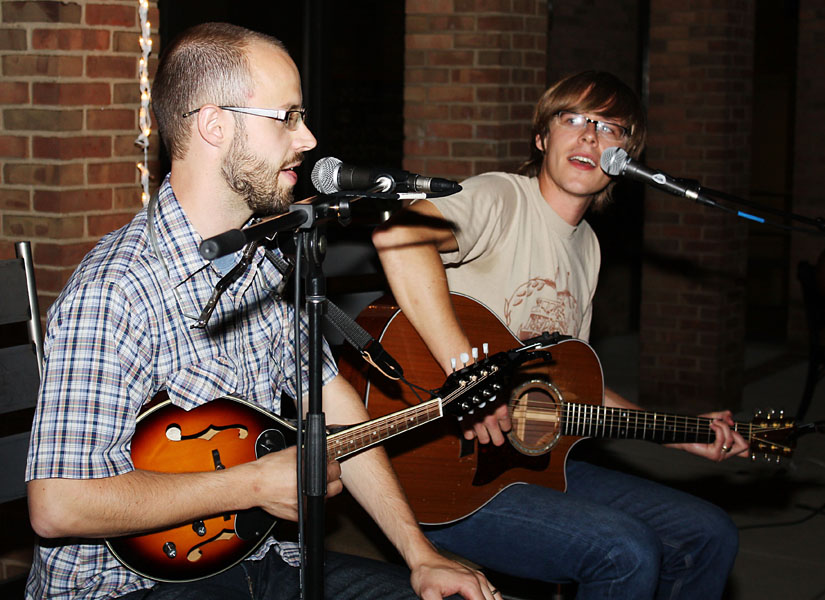 Zach Hawkins and Pete Nelson of Jayber Crow sing and play guitar and mandolin on the KMY lawn