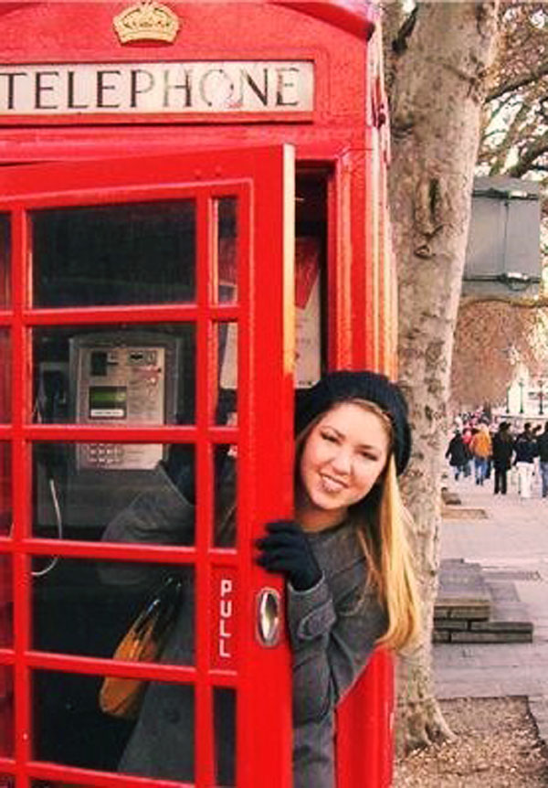 Kate Walker poses for a picture in a British telephone box