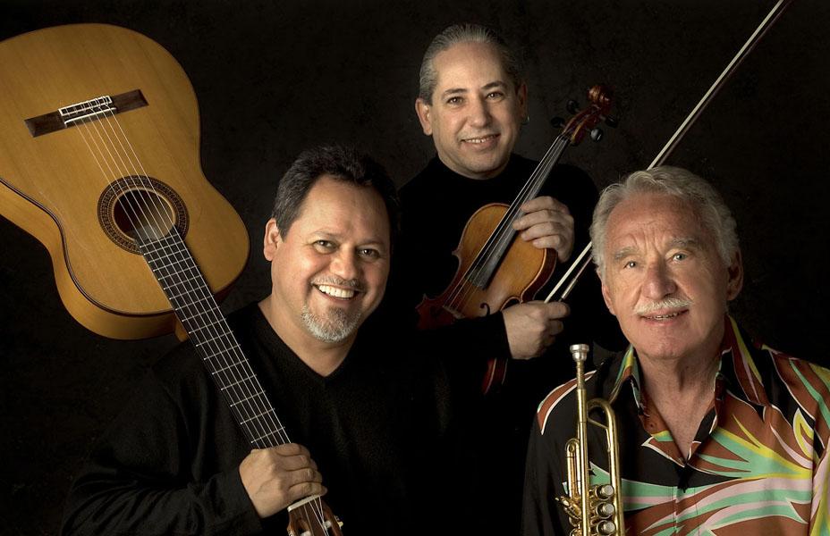 Ritmo de la Vida and Doc Severinsen pose for a picture with their instrumetns