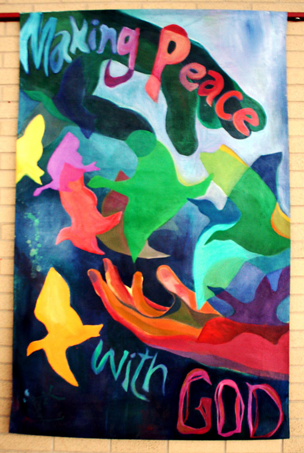 """Andrea Kraybill's colorful banner reads """"Making Peace with God"""""""