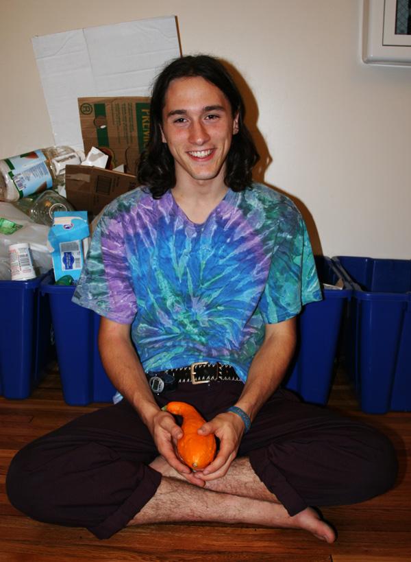 Noah Weaverdick smiles for the camera while peeling an orange