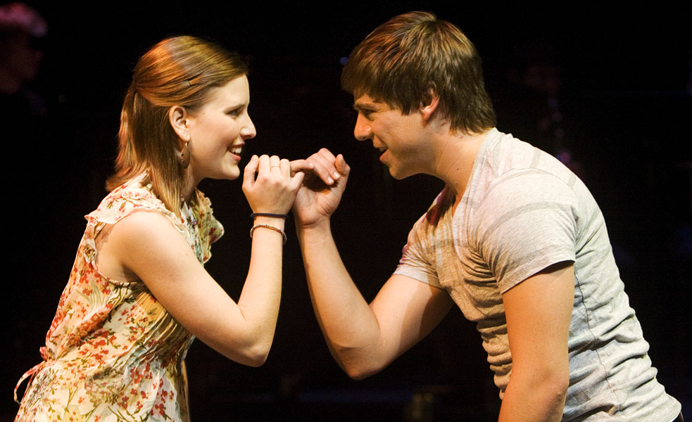 """Allison Yoder and Adriel Santiago link pinkies during a performance of """"Achilles Heel"""""""