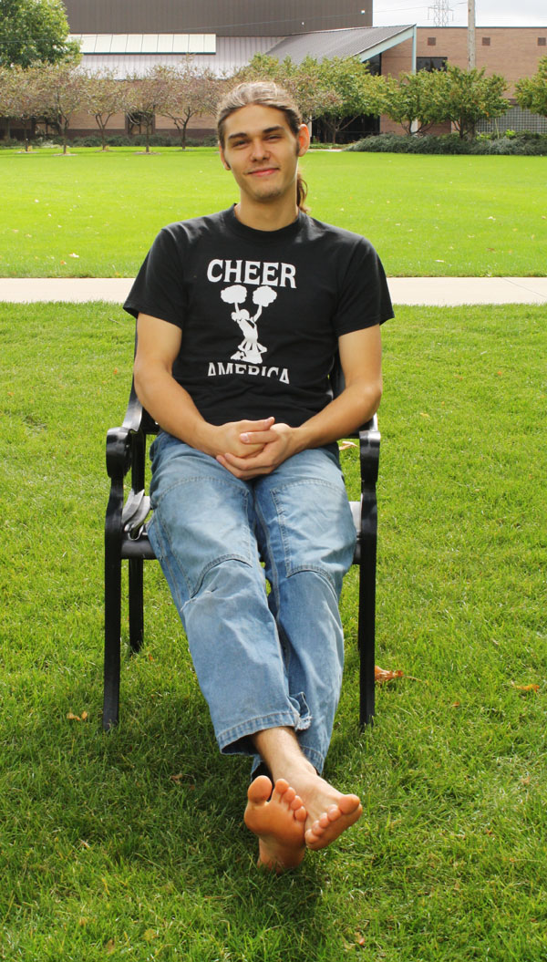 Phil Stoesz sits in a chair on the lawn