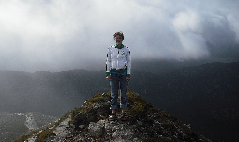 Sarah Rich stands on a cliff in Ireland