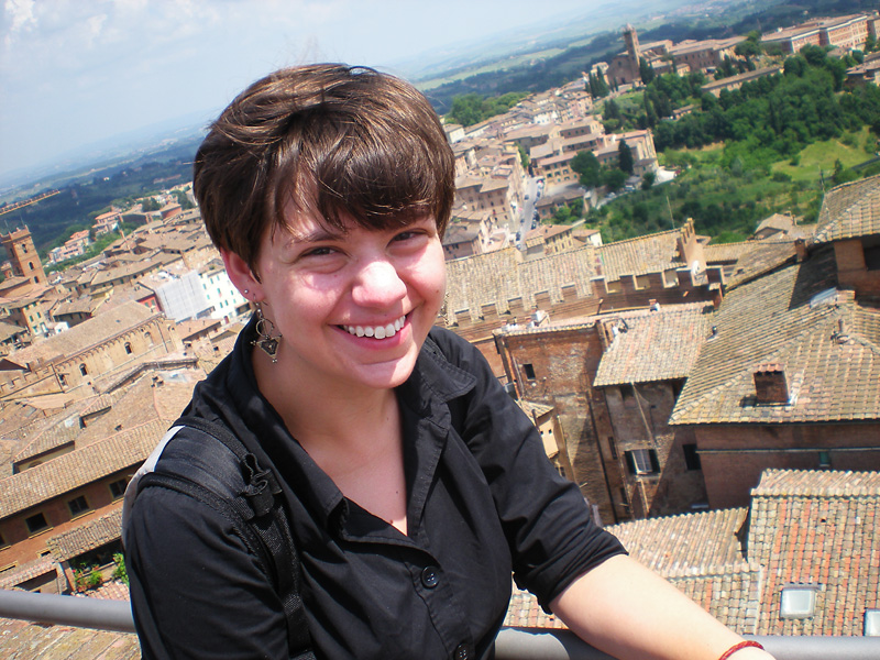 Tillie Yoder smiles for the camera in a European city