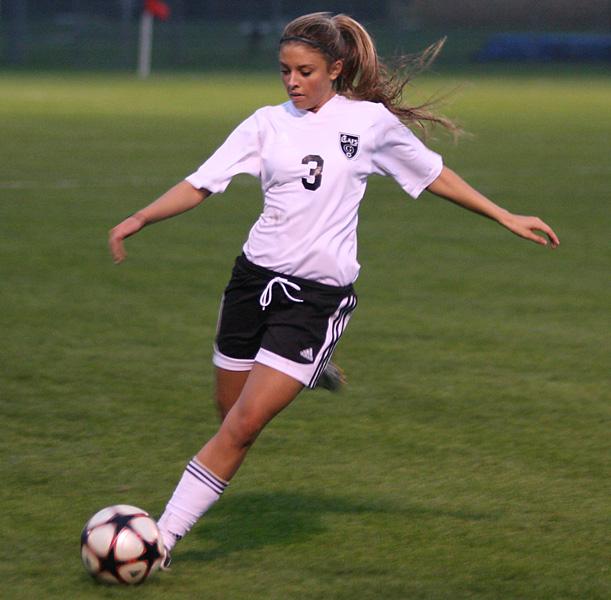 Mault kicking soccer ball