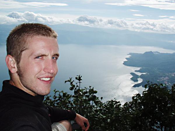 Kris Miller stands on an overlook in Guatemala