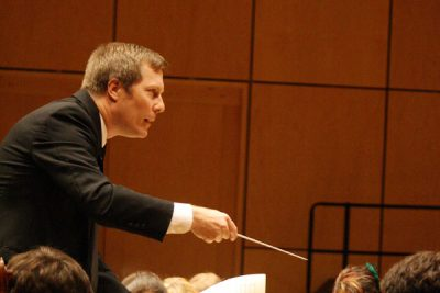 Gregg Thaller conducts the Goshen College orchestra on the Sauder Concert Hall stage