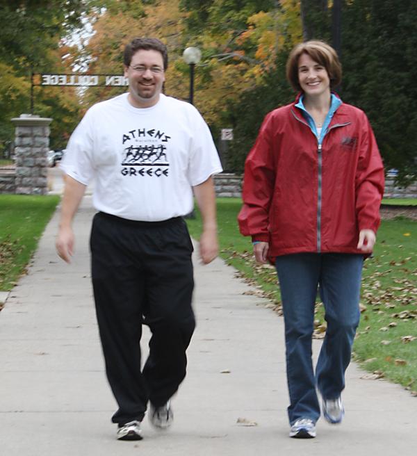 Bob and Pamela yoder walk on campus