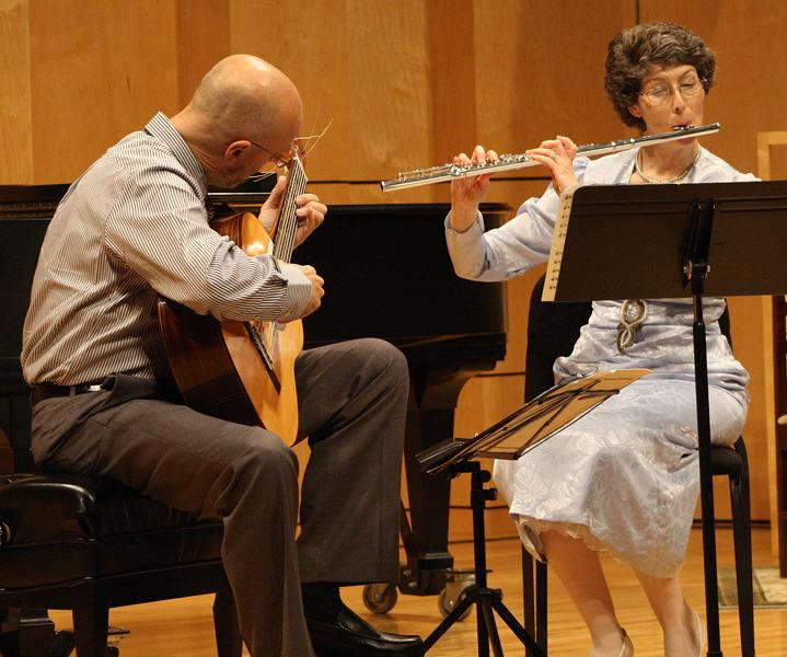 Matthias Stegmann plays guitar and Rebecca Hovan plays flute in Rieth Recital Hall