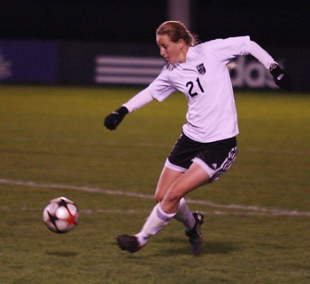 Heather Zimmerman seeks control of the ball in the Women's soccer match against Cornerstone.  Photo by Martin Brubaker.