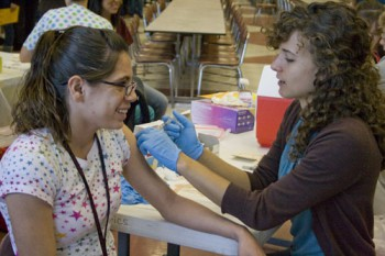 Michelle Kauffman, right, a senior nursing major, was one of several nursing students who administered H1N1 vaccines at Goshen High School on Friday.  Photo by Emily Miller.