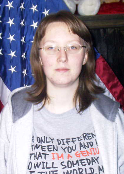 Jamie Parker stands in front of an American flag