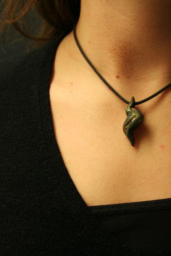 One of Alana Kenagy's handmade ceramic pendants