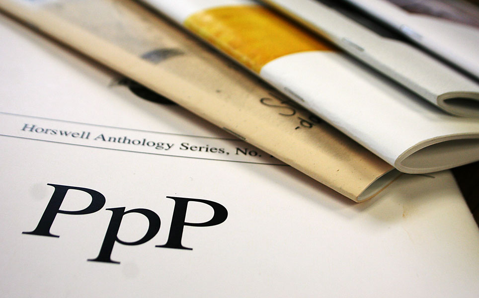 """Stack of pamphlets; one is labeled """"PPP"""" for """"Pinchpenny Press"""""""