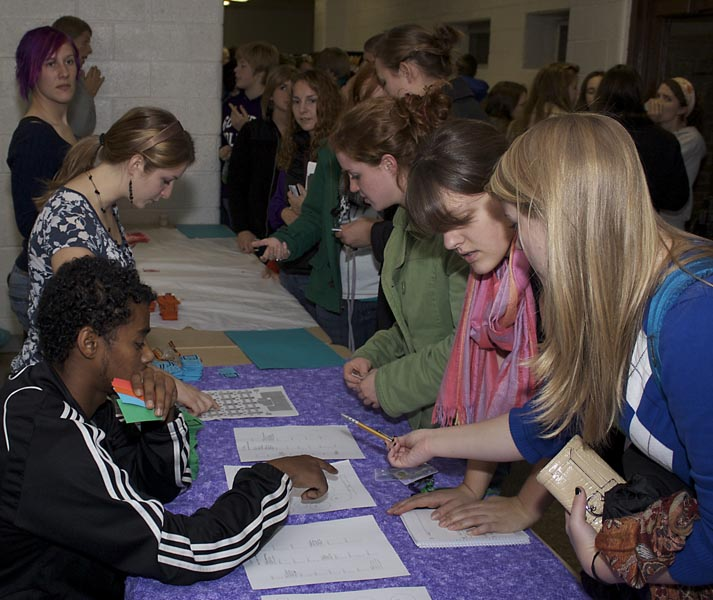 students get event tickets at a table
