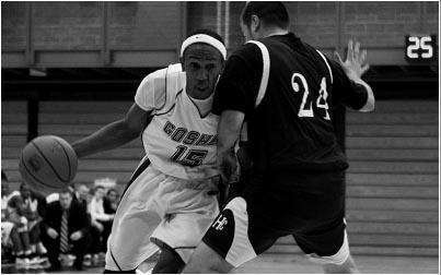 Basketball player driving with ball
