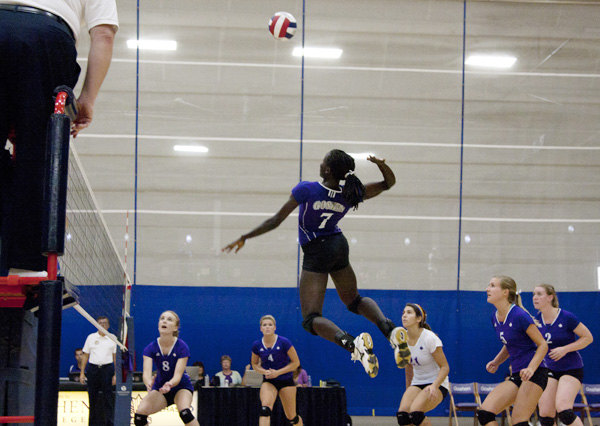 Peni jumps to spike volleyball