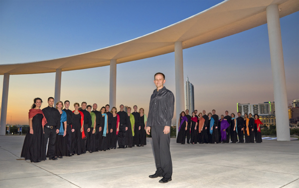 Chamber choir Conspirare and their conductor pose for an outdoor photo