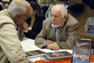 William Klassen converses with a reader at a book signing event
